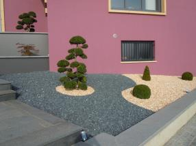 Home entrance with decorative stones and bonsai